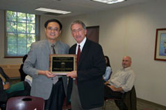 DYilin Hou, former President of CAAPA, presenting the service recognition award to William Sullivan, Assistant Dean for External Relations of the Maxwell School of Syracuse University at the 2010 Omaha conference.